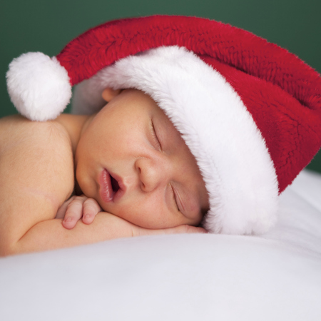 baby with a santa hat and green background